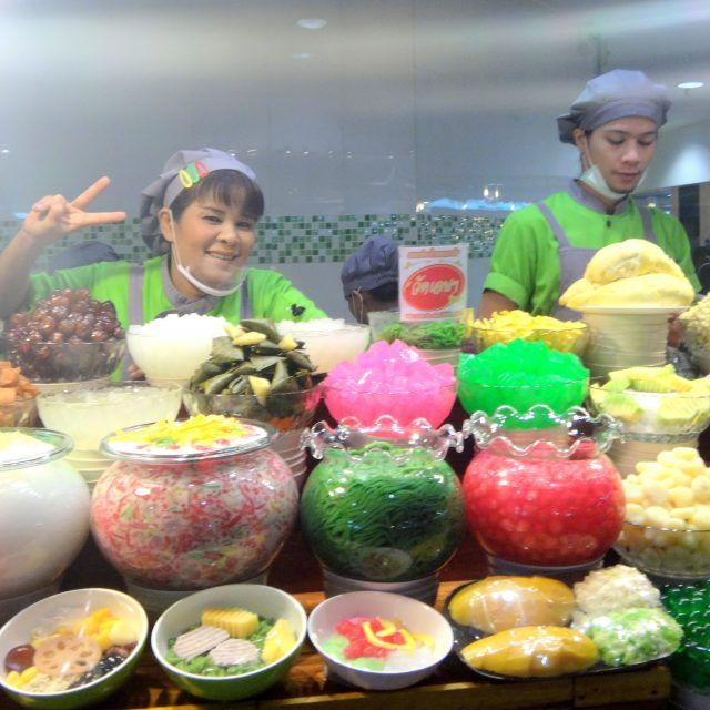 Dessert sellers at Food Island on the 6th floor of the MBK food court in Bangkok surrounded by their brightly coloured desserts make for a great sweet treat in Bangkok.
