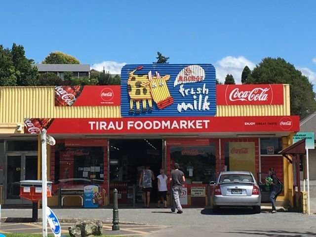 Even big companies are joining in the trend for corrugated iron signs in Tirau New Zealand