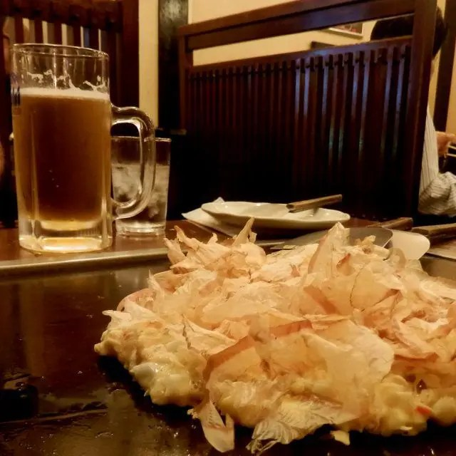 Okonomayaki is a form of Japanese pancake made from flour, eggs, cabbage and whatever else the chef has hanging around.