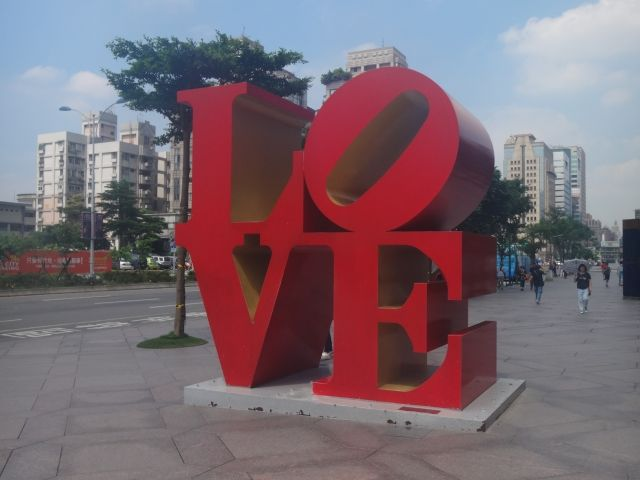 Red Sculpture spelling the word love outside Taipei 101.