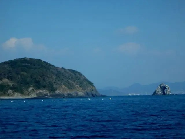 Glasses Rock, a natural rock arch off the coast of Ainoshima, aka Cat Heaven Island after the many cats who live there.
