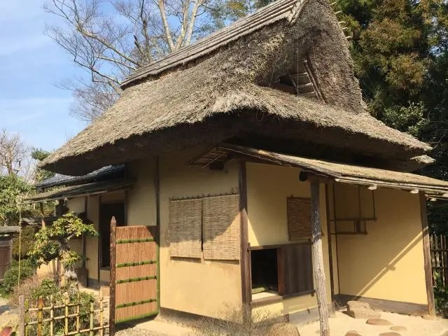The old thatched teahouse in Matsue Japan, it has a pointed roof that matches the castle opposite