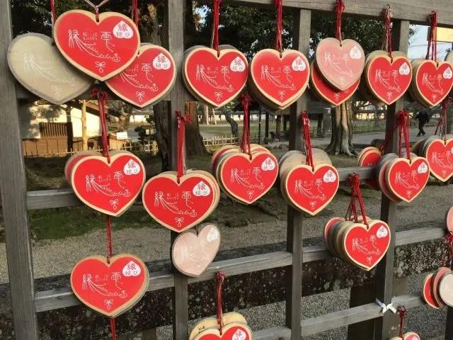 Heart shaped ema - prayer plaques - in Matsue Castle shrine.Japan
