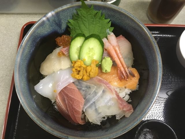 Dish of seven different types of sushi including salmon, tuna, prawn and squid topped with uni from Fukuoka Fish Market.