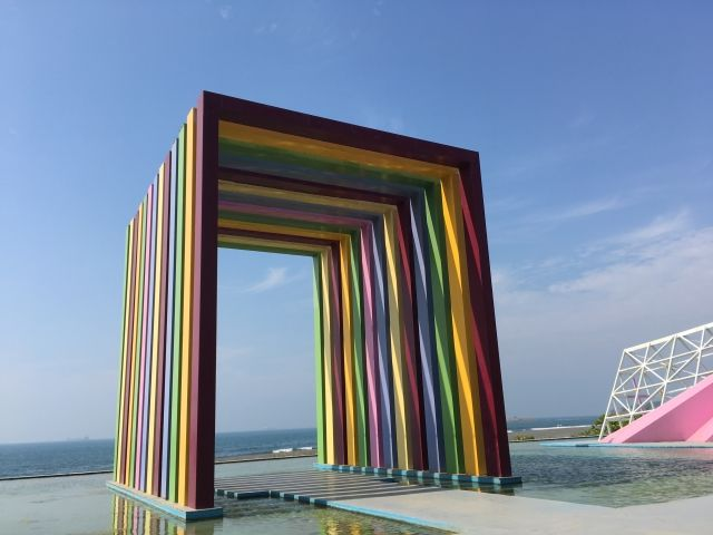 Arch made of different coloured strips of plastic