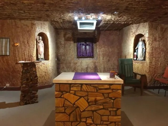 Underground church with an altar and religious statues in Coober Pedy