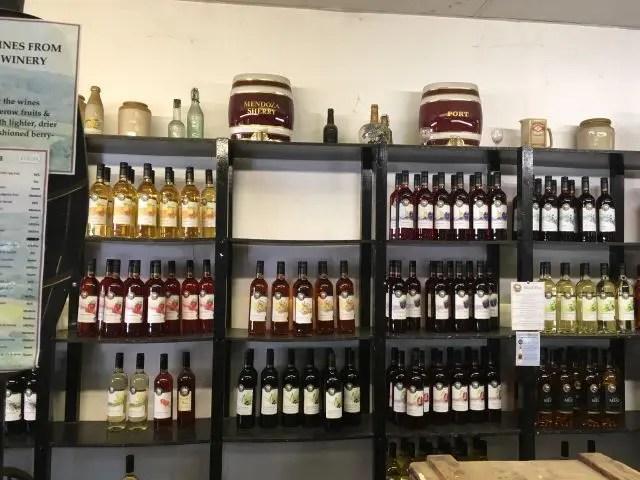 shelves full o fwine in Burley, New Forest