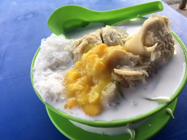 Bowl of cendol topped with durian and corn