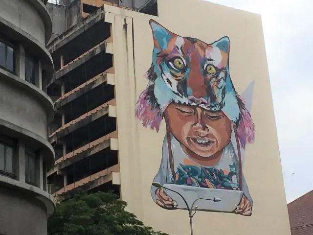 Street art mural of a boy in a tiger hat, Kuala Lumpur