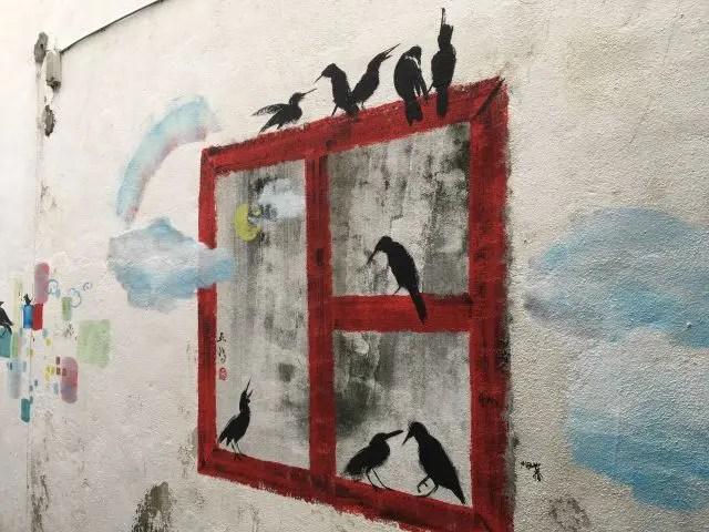 Mural of birds sitting on a window