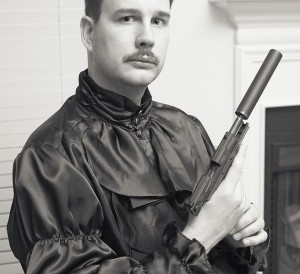Mustache and gun, that's how you know he's conservative. Srsly, all three Wikipedia images feature firearms.