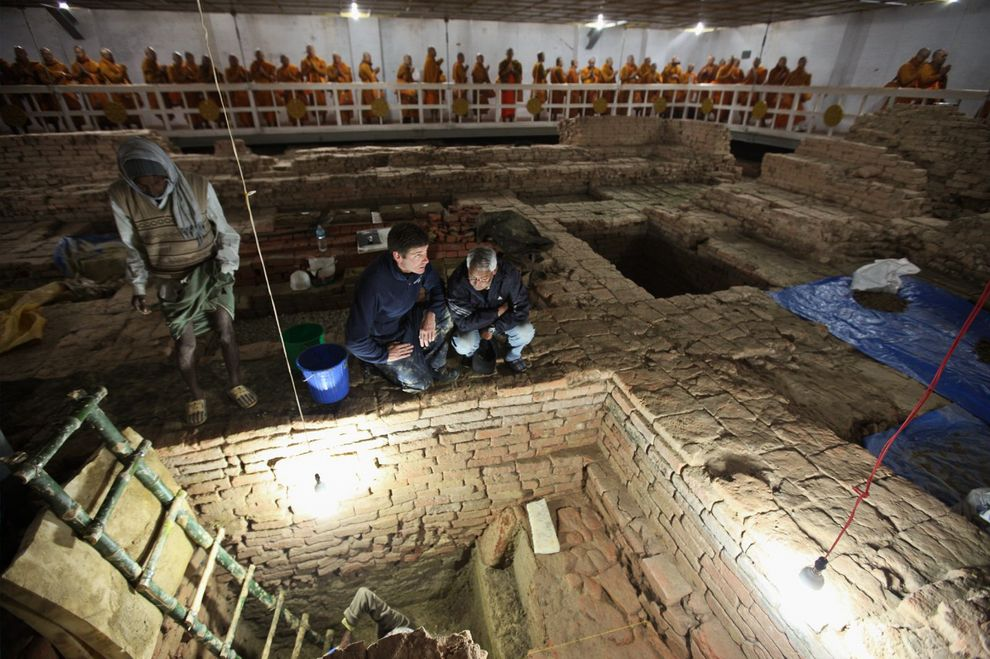 """The excavations showed that older wooden structures lay beneath the walls of the later brick Buddhist shrine. The layout of that more recent shrine duplicates the layout of the earlier wooden structures, pointing to a continuity of Buddhist worship at the site."" (NG)"