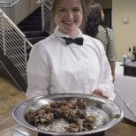 Guests at Jay Ducote's James Beard Preview Dinner enjoy bacon-wrapped duck breast Friday, July 8, 2016 at the Louisiana Culinary Institute.
