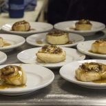 Guests at Jay Ducote's James Beard Preview Dinner enjoy Granny's Cinnamon-Pecan Rolls Friday, July 8, 2016 at the Louisiana Culinary Institute.