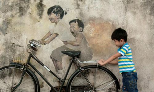 Ernest Zacharevic arte urbano en Malasia
