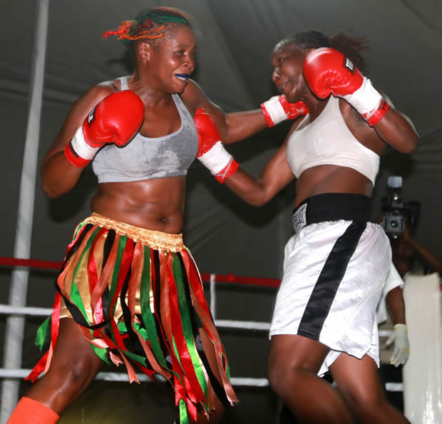 Esther Phiri during a fight with a Zimbabwean boxer in Lusaka-Picture by Tenson Mkhala