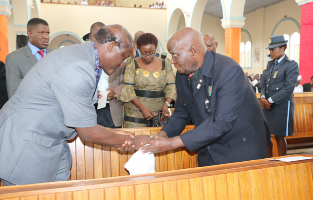 Former Justice minister Nkosa Simbyakula greets Dr Kenneth Kaunda during church service in Lusaka-picture by Tenson Mkhala