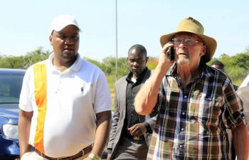Former Republican vice president Guy Scot on phone as former deputy finanace minister Miles Sampa look on in Kafue-picture by Tenson Mkhala