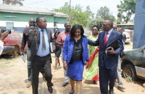 Martha Mushipe ( c) with lawyers at Woodlands police station in Lusaka-Picture by Tenson Mkhala