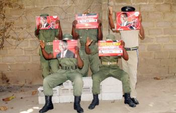 Police officers displaying UPND posters: File pictures