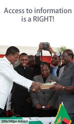 President Edgar Lungu recieves an Amended Constitution from former Justice minister Ngosa Simbyakula at Heroes Stadium in Lusaka-picture by Tenson Mkhala