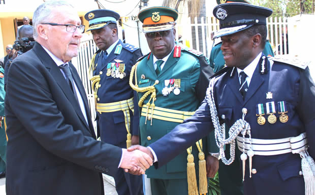 Guy Scott greets Former deputy inspector of general Solomon Jere at KKIA in Lusaka-Picture by Tenson Mkhala