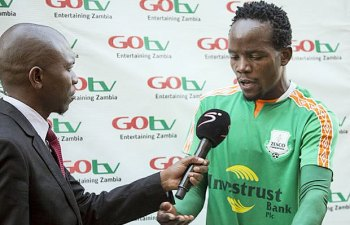 A reporter interviews Cletus Chama: File picture