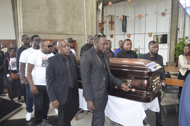 Joe Chibangu's casket being carried by different Zambian artist yesterday-Picture by Tenson Mkhala