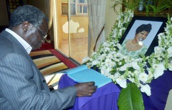People's Party leader Mike Mulongoti signs a book of condolences for the late Regina Chiluba in Lusaka-Picture by Tenson Mkhala