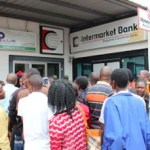 Depositors at Intermarket Bank after BoZ took over its possession