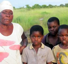 The three children adopted by Stella Sata-Rukayi with their grandmother