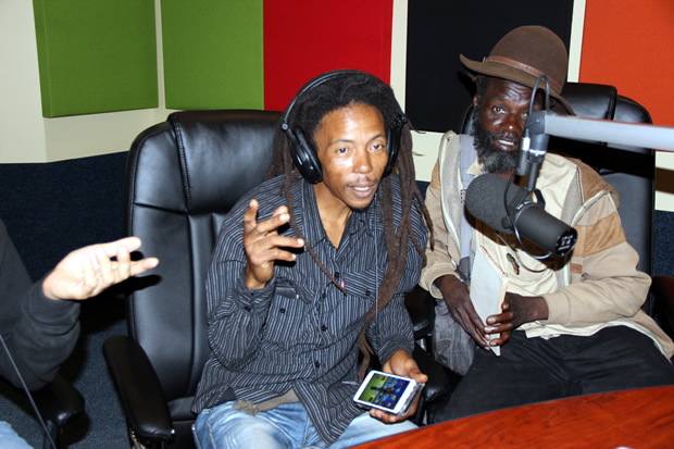 Human Rights Activist Maiko Zulu on UNZA radio when he featured on Lusaka Star program as artist Chris Khuzuwayo looks on-picture by Tenson Mkhala
