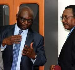 IMF leader of delegation Tsidi Tsikata and secretary to Treasury Fedson Yamba shortly after press briefing in Lusaka-picture by Tenson Mkhala