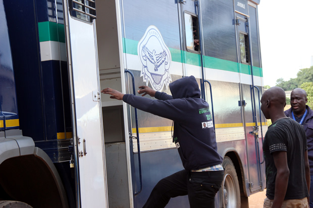 Joseph Chingangu gets into the police truck 'Kasalanga' shortly after appearing at Lusaka's Magestrates court for house breaking in Lusaka - picture by Tenson Mkhala