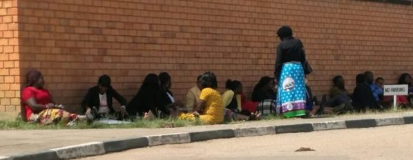Some ZNBC employees sitting outside the Mass Media studio