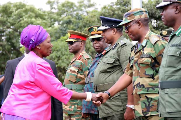 Vice president Inonge Wina greets deputy defense and security chiefs during Youth Day celebrations in Lusaka-picture by Tenson Mkhala