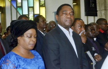UPND leader Hakainde Hichilema, wife Mutinta and his deputy Geoffrey Bwalya Mwamba at Regina's requiem mass in Lusaka-picture by Tenson Mkhala