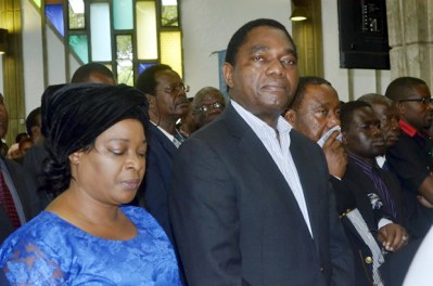 UPND leader Hakainde Hichilema, wife Mutinta and his deputy Geoffrey Bwalya Mwamba at Regina's requiem mass in Lusaka-picture by Tenson Mkhala