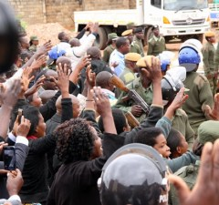 UPND supporters wave at their leader Hakainde Hichilema as he was taken back to Lusaka Central Prison-Picture by Tenson Mkhala