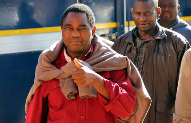 UPND leader Hakainde Hichilema coming out of police vehicle 'Kasalanga' at Lusaka's Magistrates Court-picture by Tenson Mkhala