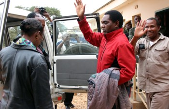 UPND leader Hakainde Hichilema waves at his supporters at Lusaka's Magistrates Court before being taken to Lusaka Central Prisons-pictures by Tenson Mkhala
