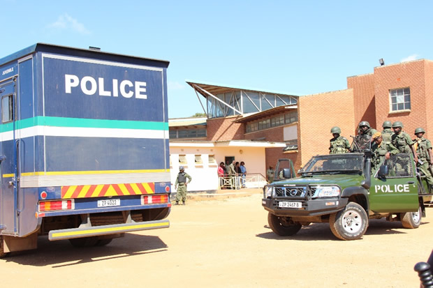 Police officer at Court as HH appears for treason-Picture by Tenson Mkhala
