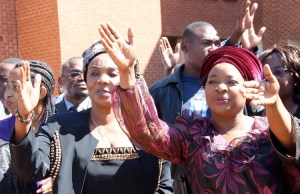 Hakainde Hichilema's wife Mutinta with GBM's wife Chama at Court -Picture by Tenson Mkhala