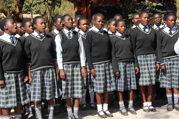St Columbus Secondary School pupils sing during the launch of the library – picture by Tenson Mkhala