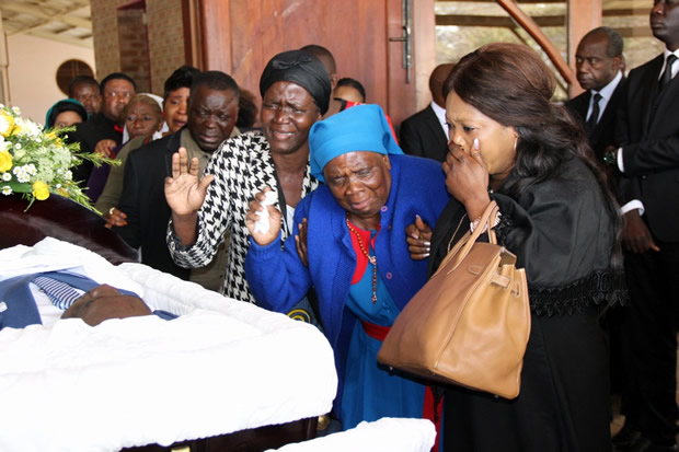 Mourners during church service of late Health permanent secretary John Moyo at the Cathedral of the Child Jesus Catholic church in Lusaka picture by Tenson Mkhala