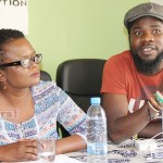 Alliance for Community Action executive director Laura Miti listens to Chama Fumba a.k.a Pilato during a Joint for Accountability in Zambia (JAZZ) press briefing on the planed citizen demonstration to demand a full disclosure of public resources management process leading to purchase of 42 fire tendres in Lusaka on September 26, 2017. Picture by - Tenson Mkhala