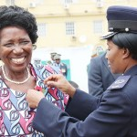 Vice-President Inonge Wina jokes with photographers as her bodyguard puts a poppy pin on her  at the Remembrance Day parade at the National Cenotaph in Lusaka on November 12, 2017 - Picture by Tenson Mkhala