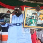 Kambwili displays a picture of candidate Edgar Lungu before he was elected President - Picture by Joseph Mwenda