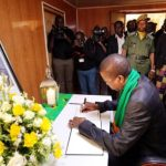President Edgar Lungu signs in then book of condolences at Daniel Munkombwe's funeral