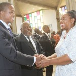 President Edgar Lungu shake hands with Former First lady Maureen Mwanawasa at Cathedral of the Holy Cross during the 10th memorial celebrations of late President Levy Patrick Mwanawasa as Presidential Affairs minister Freedom Sikazwe looks on, on August 19, 2018 – Picture by Tenson Mkhala